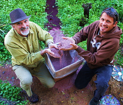 Ken Foster, left, and 'Flea' Virostko display the crushed rose petals they'll raffle off on Valentine's Day. (Chip Scheuer)