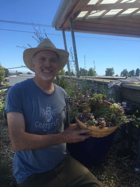 Ken at Rainbow Light's rooftop herb garden